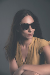 Brunette fashion woman with brown sunglasses, yellow dress and w