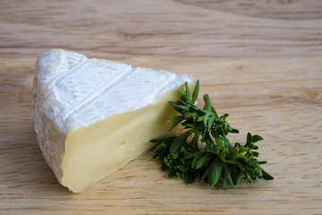 Camembert cheese with parsley
