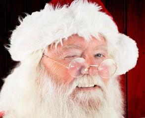 Composite image of santa claus winking