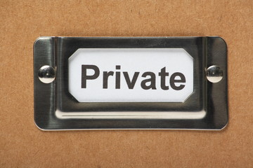 Drawer label on a cardboard box for your private items