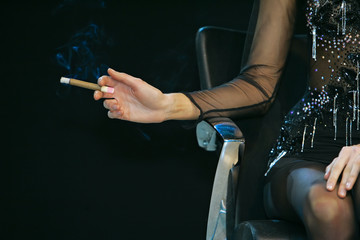 Woman sitting on a chair with a cigarette