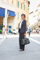 Young Fashionable Businesswoman in the City