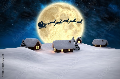 Leinwandbild Motiv Composite image of snow covered houses