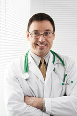 Friendly male doctor smiling