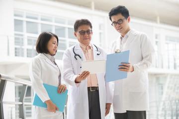 Asian medical team of doctors meeting  inside hospital building