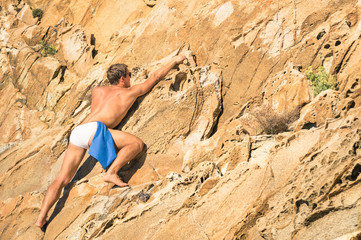 Young athletic man free climbing - Freedom extreme sports