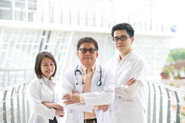 Asian medical team standing inside hospital building