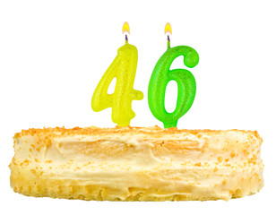 birthday cake with candles number forty six isolated on white