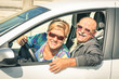Leinwanddruck Bild - Happy senior couple ready for driving a car on a journey trip