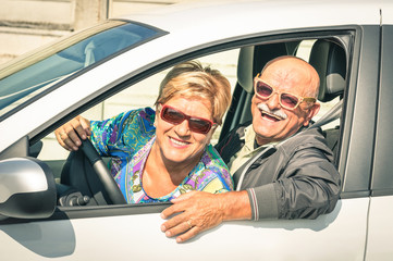 Happy senior couple ready for driving a car on a journey trip