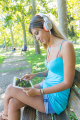 Beautiful Young Woman with Digital Tablet at Park