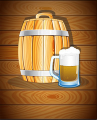 Wooden barrel and a glass of beer