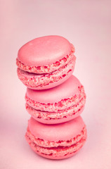 Macaroons on light pink  background