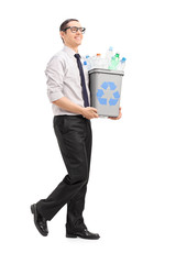 Young man carrying a recycle bin