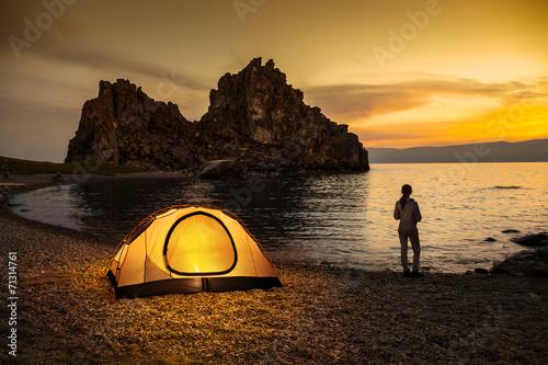 Alone tourist near tent and lakeshore - 71314761