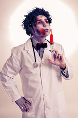 a zombie doctor with a syringe with blood, with a filter effect
