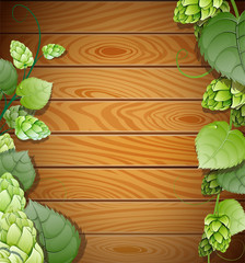 Hops on wooden background