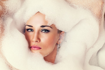 art portrait of a beautiful blond woman in the foam