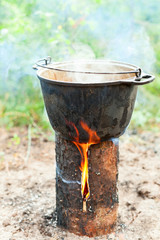 Cooking on Scandinavian log candle