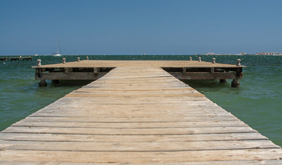 A wooden jetty, stretching out into the Mediterranean sea