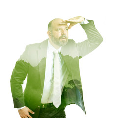 business man double exposure green tree