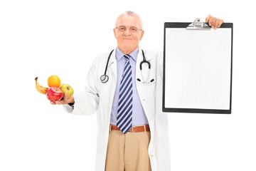 Doctor holding clipboard and a bunch of fruits