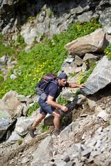 Hiker climbing the mountain