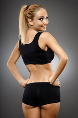 Fitness girl on gray background