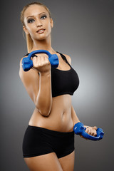 Fitness lady working with dumbbells
