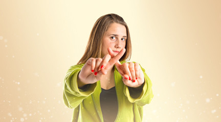 Girl doing NO gesture over gloss background