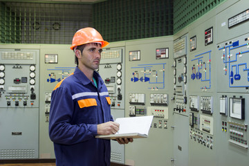 Engineer on main control panel of gas compressor station