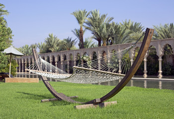 modern hammock in a luxurious garden