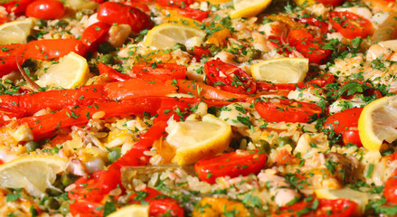 paella valenciana with seafood and vegetables
