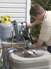 AC Repairman Charges Unit With Freon