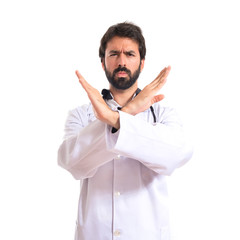 Doctor doing NO gesture over white background