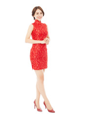 young woman making a elegant pose with cheongsam.