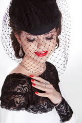 Beautiful Brunette Woman. Retro Fashion portrait in elegant hat