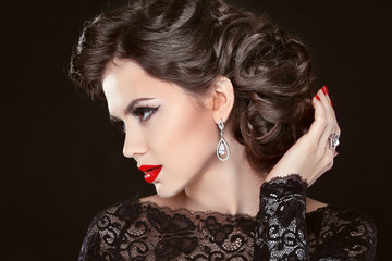 Beautiful elegant girl model with jewelry, makeup and retro hair