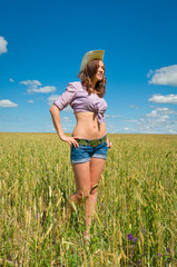 Woman in a cowboy hat and jeans shorts