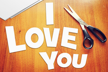 Text I Love You. Scraps of paper