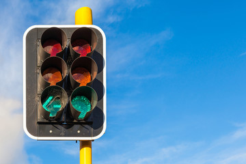 The grungy traffic lights with beautiful blue sky in backgrounds