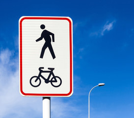 Bicycle and pedestrian lane road sign on pole post, bike cycling