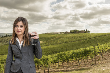 Woman Sommelier in the vineyards of tuscany