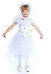 Little girl dressed as a white princess.