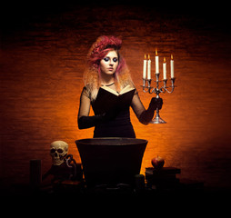 Witch making witchcraft in dungeon. Halloween composition.