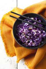 sauteed purple cabbage on bowl with japanese chopsticks