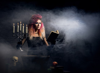 awitch making witchcraft on a smoky Halloween background