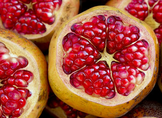 Juicy red pomegranate fruit, close-up