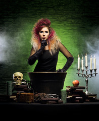 Beautiful witch on a smoky background. Halloween image.