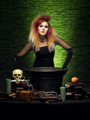 Beautiful witch making witchcraft over on Halloween
